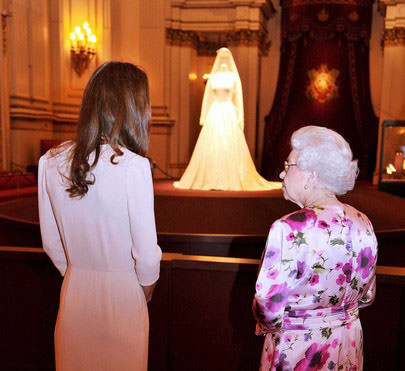 Britain's Queen Elizabeth and Catherine, the Duchess of Cambridge, look at Catherine's wedding dress, at Buckingham Palace in London