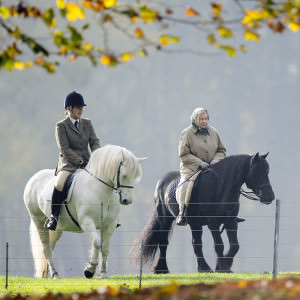 Queen Elizabeth II accompanied by a Groom out riding by the River Thames at Windsor, Berkshire, Britain - 02 Nov 2015